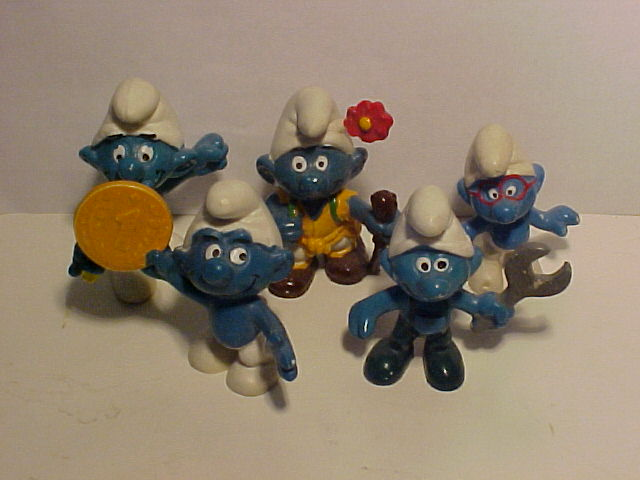Smurfs including a mechanic and a winner who must be the driver